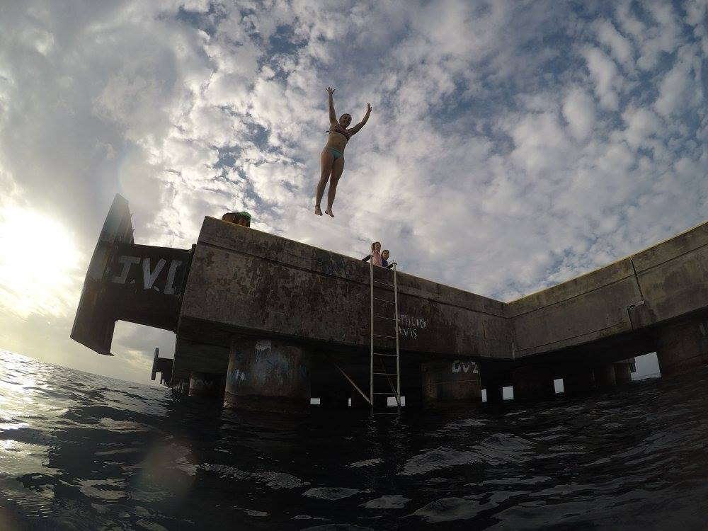 Jumping off Frederiksted Pier before diving underneath